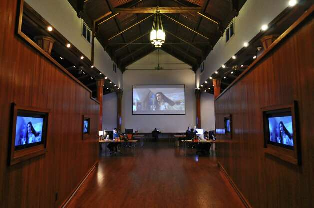 "The movie ""Labyrinth"" plays on a screen on the production floor of Overit Media's new home on New Scotland Avenue, in what used to be the sanctuary of the former St. Teresa of Avila church on Monday Oct. 8, 2012 in Albany, NY.  (Philip Kamrass /  Times Union) Photo: Philip Kamrass"