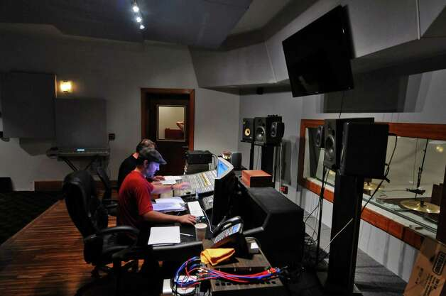 A control room with mixing board overlooks a soundstage adjacent to the space that was formerly an altar in Overit Media's new home on New Scotland Avenue, in what used to be the sanctuary of the former St. Teresa of Avila church on Monday Oct. 8, 2012 in Albany, NY.  (Philip Kamrass /  Times Union) Photo: Philip Kamrass / 00019569A