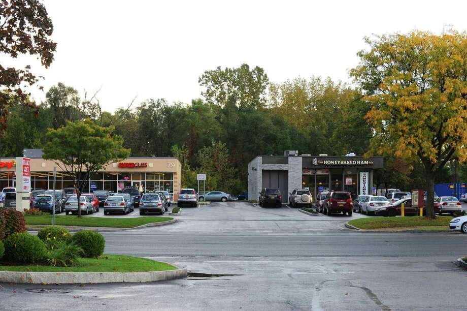 Future site of Staybridge Suites in the wooded area behind this plaz on the north end of the Macy's lot at the Colonie Center in Colonie, NY Wednesday Oct. 10, 2012. (Michael P. Farrell/Times Union) Photo: Michael P. Farrell