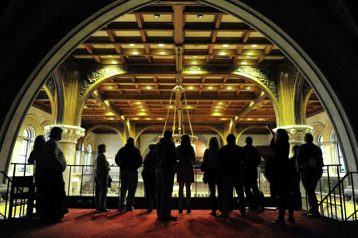 Maeve McEneny, third from right, a Capitol tour guide, stands in the balcony of the Assembly chambers as she leads a Capitol Hauntings tour of the New York State Capitol on Thursday, Oct. 11, 2012 in Albany, NY. The annual tours explore the legends, folklore and ghost stories connected to the Capitol. The Capitol Hauntings tours are free and open to the public with tours being offered at noon and 5:30 p.m. Monday through Friday (except Columbus Day), from October 7 to November 1. Pre-registration is required and individuals and groups of 10 or less may register online at www.ogs.ny.gov. Larger parties may call 473-7582 to register. (Paul Buckowski / Times Union)
