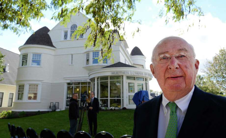Richard J. Huether stands in front of the school that bears his name as the new Huether School of Business was dedicated today on the College of Saint Rose in Albany, N.Y. Oct. 11, 2012.     (Skip Dickstein/Times Union) Photo: Skip Dickstein / 00019618A