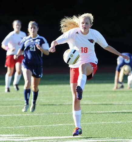 Ar right, Isbella Pehrson # 18 of Greenwich advances the ball while being pursued by Gea Mitas # 21 of Staples during the girls high school soccer match between Greenwich High School and Staples High School at Greenwich, Thursday, Oct. 11, 2012. Photo: Bob Luckey / Greenwich Time