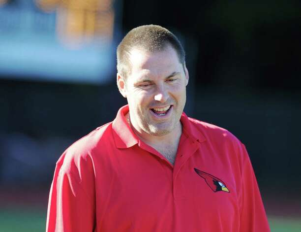 Danny Simpson, Greenwich girls soccer coach, smiles at the start of the girls high school soccer match between Greenwich High School and Staples High School at Greenwich, Thursday, Oct. 11, 2012. Photo: Bob Luckey / Greenwich Time