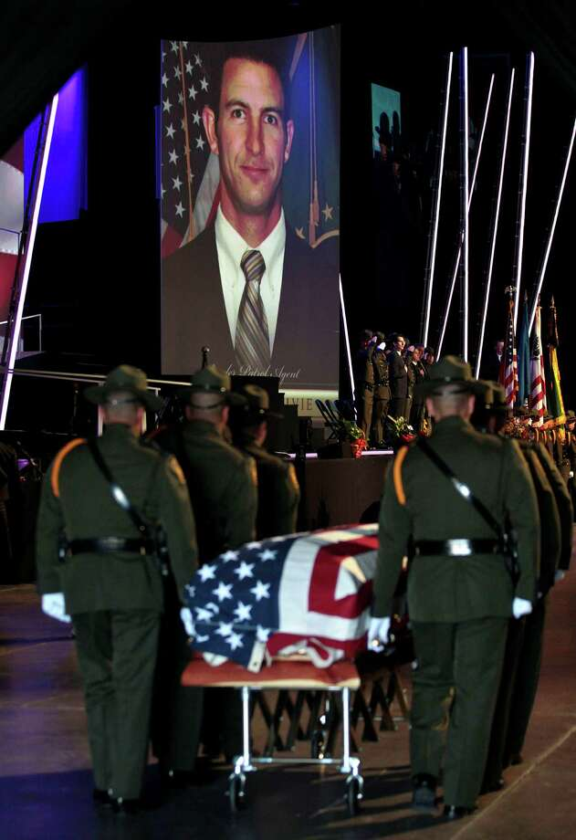 U.S. Border Patrol agents carry the casket containing the body of Border Patrol agent Nicholas Ivie into his funeral on October 11, 2012 in Orem, Utah. Ivie was shot to death as he was patrolling the U.S. Mexican border on October 2, 2012 near Naco, Arizona. Photo: George Frey, Getty Images / 2012 Getty Images