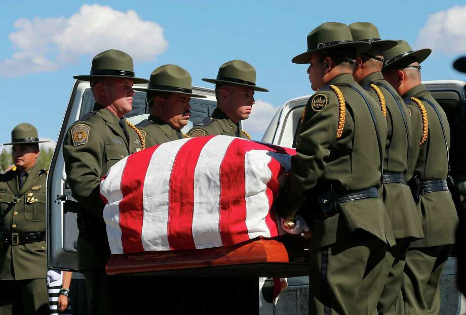 U.S. boarder patrol agents carry the casket of boarder patrol agent Nicholas Ivie, to a graveside service in Spanish Fork cemetery on October 11, 2012 in Spanish Fork, Utah. Ive was shot to death as he was patrolling the U.S. Mexican boarder on October 2, 2012 near Naco, Arizona. Photo: George Frey, Getty Images / 2012 Getty Images