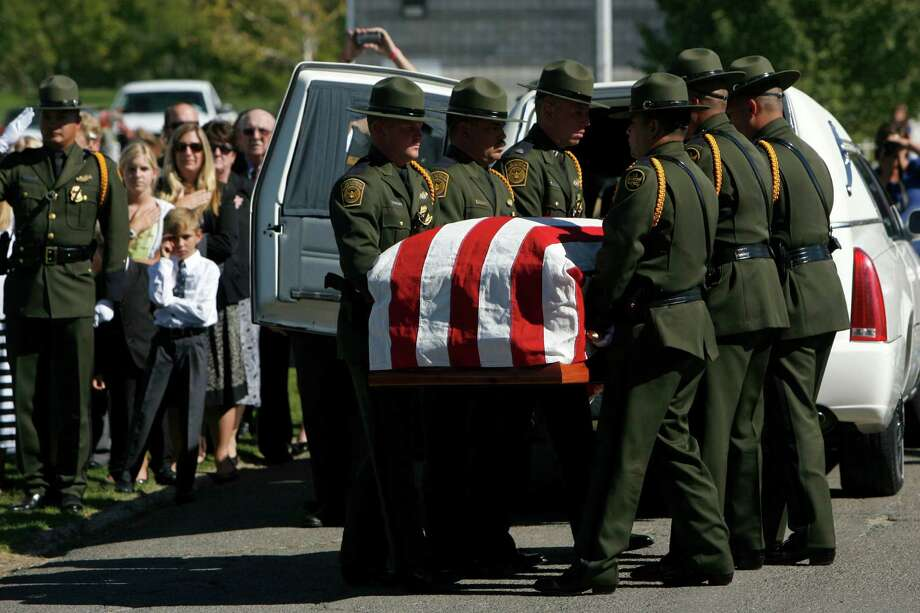 U.S. Customs and Border Patrol agents move the casket containing border patrol agent Nicholas Ivie after arriving at the Spanish Fork Cemetery in Spanish Fork, Utah, surrounded by friends, family, and numerous service agencies on Thursday, Oct. 11, 2012. Photo: Francisco Kjolseth, Associated Press / The Salt Lake Tribune