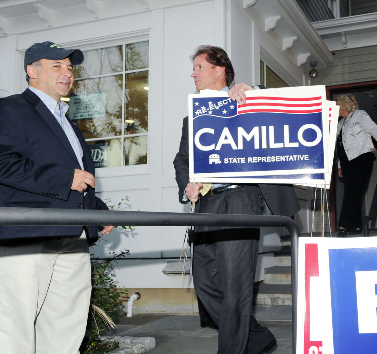 At left, State Rep. Alfred Camillo, R-151st District, speaks with state Sen. L. Scott Frantz, R-36th District, as Frantz holds re-elect Camillo for state representative signs during the opening of the Greenwich Republicans campaign headquarters at 1076 E. Putnam Ave., Riverside, Thursday, Oct. 11, 2012.