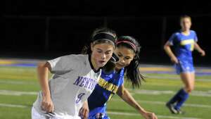 Girls soccer action between Newtown High Schools Jessica Keller and Brookfield High Schools Jasmine Dasilval during their game Thursday October 12, 2012 at Newtown.