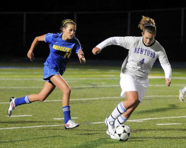 Girls soccer action between Newtown High Schools Tressa Scott and Brookfield High Schools Jessica Becker during their game Thursday October 12, 2012 at Newtown. Photo: Lisa Weir
