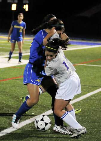 Girls soccer action between Newtown High Schools Brittany Tolla and Brookfield High Schools Christina Merkle during their game Thursday October 12, 2012 at Newtown. Photo: Lisa Weir