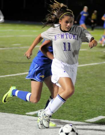 Girls soccer action between Newtown High Schools Brittany Tolla and Brookfield High Schools Sarah Lynch during their game Thursday October 12, 2012 at Newtown. Photo: Lisa Weir