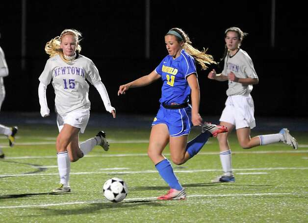 Girls soccer action between Newtown High Schools Amy Martin and Brookfield High Schools Carly Cobbol during their game Thursday October 12, 2012 at Newtown. Photo: Lisa Weir
