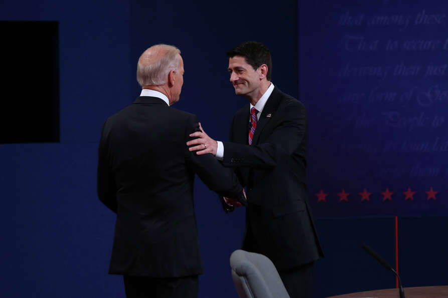 DANVILLE, KY - OCTOBER 11:  U.S. Vice President Joe Biden (L) shakes hands with Republican vice pres