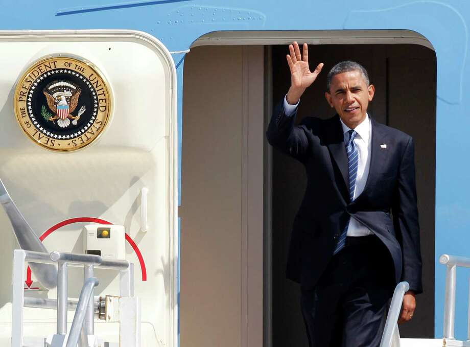 President Barack Obama waves as he steps out of Air Force One upon his arrival at Miami International Airport, Thursday, Oct. 11, 2012 in Miami. (AP Photo/Wilfredo Lee) Photo: Wilfredo Lee