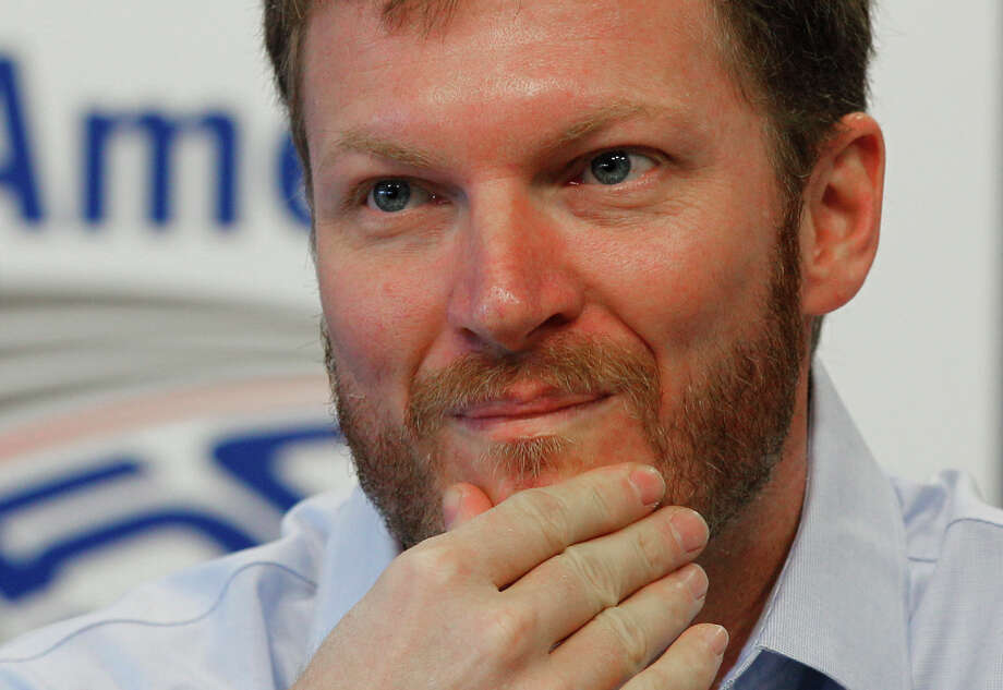 Dale Earnhardt Jr pauses as he talks about missing the next two races with his second concussion in the past six weeks during a news conference prior to practice for Saturday's NASCAR Bank of America 500 NASCAR Sprint Cup series auto race in Concord, N.C., Thursday, Oct. 11, 2012. (AP Photo/Chuck Burton) Photo: Chuck Burton