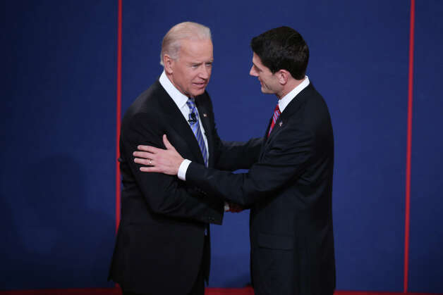 DANVILLE, KY - OCTOBER 11:  U.S. Vice President Joe Biden (L) shakes hands with Republican vice presidential candidate U.S. Rep. Paul Ryan (R-WI) (R) during the vice presidential debate at Centre College October 11, 2012 in Danville, Kentucky.  This is the second of four debates during the presidential election season and the only debate between the vice presidential candidates before the closely-contested election November 6.  (Photo by Win McNamee/Getty Images) Photo: Win McNamee, Getty Images / 2012 Getty Images