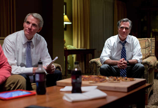 Republican presidential candidate, former Massachusetts Gov. Mitt Romney, right, watches the vice presidential debate with Sen. Rob Portman, R- Ohio, left, in his hotel room on Thursday, Oct. 11, 2012 in Asheville, N.C.  (AP Photo/ Evan Vucci) Photo: Evan Vucci, AP / AP2012