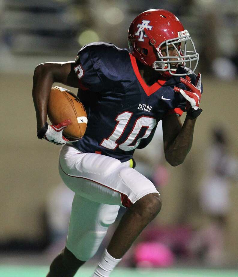 Alief Taylor's Josh Kalu (10) runs the ball during the first half of the Nimitz High school football game played against Alief Taylor at Crump Stadium, Thursday, Oct. 11, 2012, in Houston. Photo: Karen Warren, Houston Chronicle / © 2012  Houston Chronicle