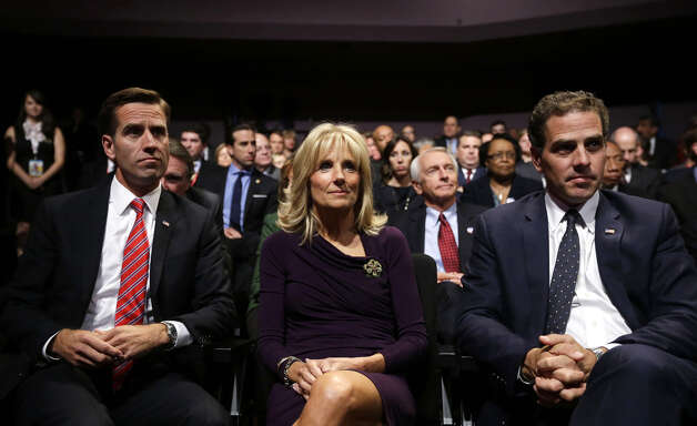 Jill Biden, center, wife of Vice President Joe Biden, sits with her sons Beau Biden, left, and Hunter Biden, right, before the start of the vice presidential debate, at Centre College in Danville, Ky., Thursday, Oct. 11, 2012. (AP Photo/Pablo Martinez Monsivais) Photo: Pablo Martinez Monsivais, AP / AP2012