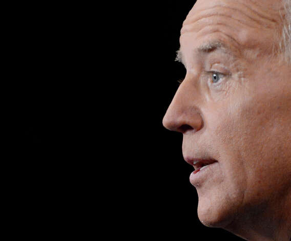 Vice President Joe Biden answers a question during the vice presidential debate at Centre College, Thursday, Oct. 11, 2012, in Danville, Ky. (AP Photo/Pool-Michael Reynolds) Photo: Michael Reynolds, AP / AP2012