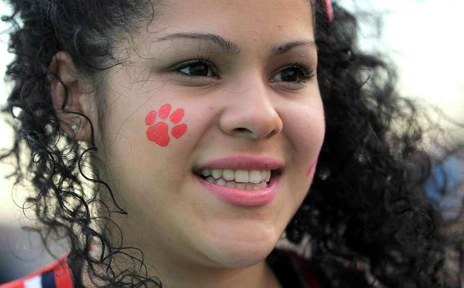 Alief Taylor cheerleader Jemina Oreira, 16, before the start of the Nimitz High school football game played against Alief Taylor at Crump Stadium, Thursday, Oct. 11, 2012, in Houston. Photo: Karen Warren, Houston Chronicle / © 2012  Houston Chronicle