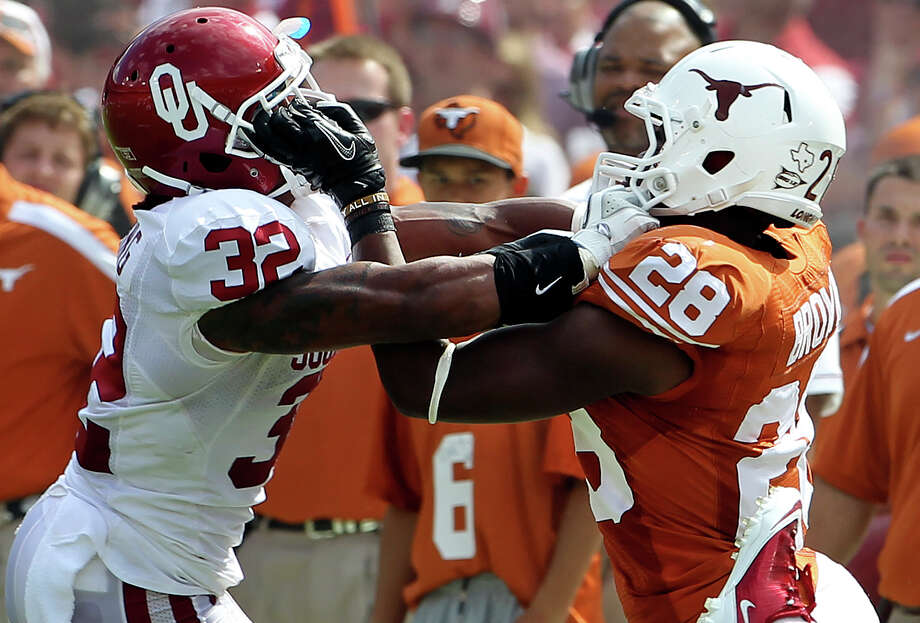 Oklahoma cornerback Jamell Fleming, left, and Texas running back Malcolm Brown took an in-your-facemask approach to last year's Red River Rivalry game, won by the Sooners 55-17. Photo: TOM REEL / © 2011 San Antonio Express-News