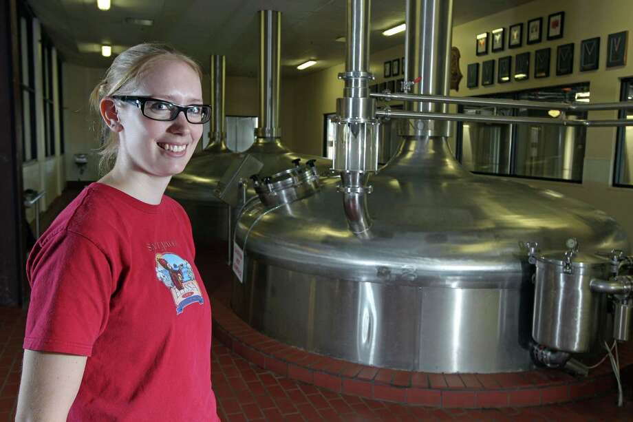 Claire Winder's work at Saint Arnold Brewing Co. requires physical strength and a special wardrobe. Photo: James Nielsen / © Houston Chronicle 2012