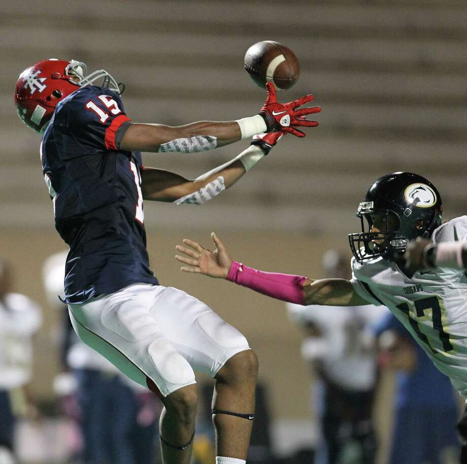 Alief Taylor's Romello Brooker (15) tries to get his hands on an incomplete pass over Nimitz's Deon Griffin (17) during the first half of the Nimitz High school football game played against Alief Taylor at Crump Stadium, Thursday, Oct. 11, 2012, in Houston. Photo: Karen Warren, Houston Chronicle / © 2012  Houston Chronicle