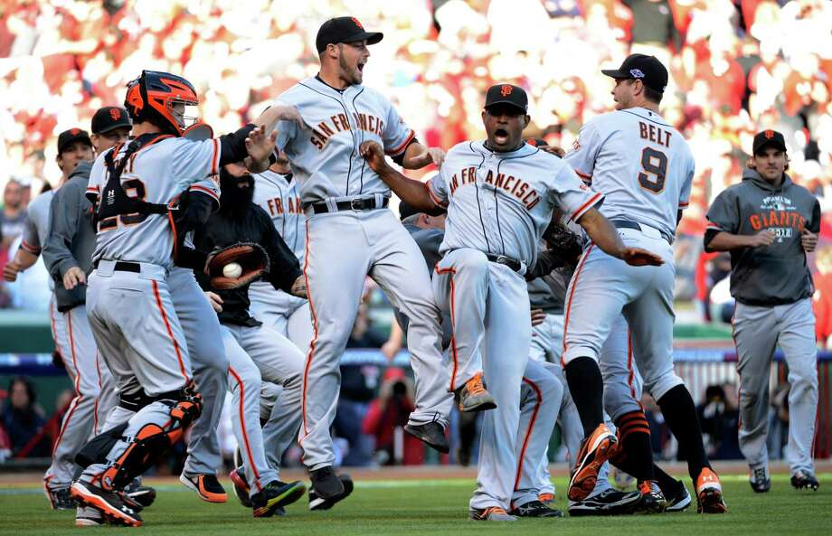 The San Francisco Giants celebrate after they defeated the Cincinnati Reds 6-4 in Game 5 of the National League division baseball series, Thursday, Oct. 11, 2012, in Cincinnati.  The Giants won the final three games, all in Cincinnati, and advanced to the NL championship series.  (AP Photo/Michael Keating) Photo: Michael Keating