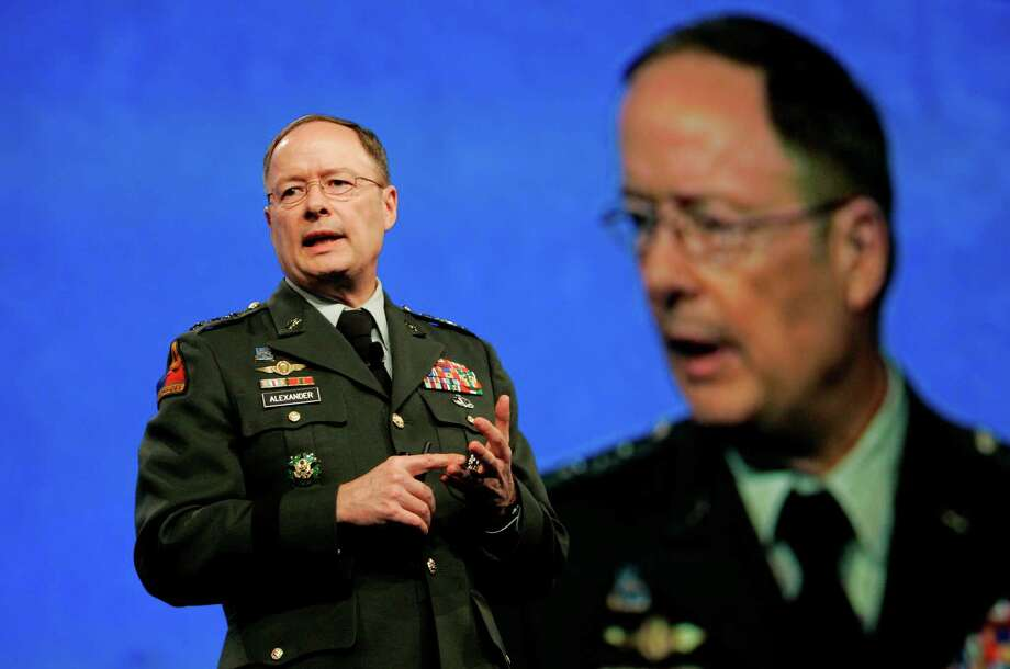 FILE - In this April 21, 2009, photo, then-Lt. General Keith Alexander, who was then-director of the National Security Agency, speaks at the RSA Conference in San Francisco. Without warning, the electricity goes out, leaving you and your family in the dark for days, perhaps weeks. Or the gates of a dam holding back millions of gallons of water open suddenly and flood towns below. Or pipes in a chemical plant rupture, releasing deadly gas. Any one, or all, of these nightmare scenarios could be invisibly set in motion by hackers, terrorist groups or foreign governments with the motivation and technical know-how. Alexander, head of U.S. Cyber Command, has rated the country's preparedness for a major cyberattack as poor, a 3 on a scale of 1 to 10. (AP Photo/Jeff Chiu) Photo: Jeff Chiu