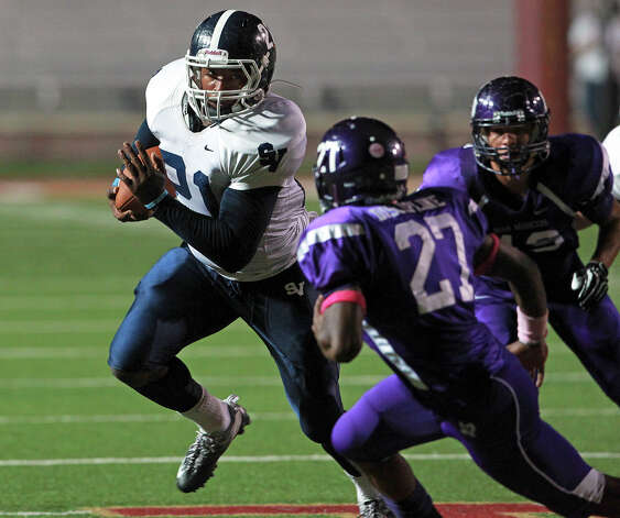 Lawrence Mattison gains yards on the right side as San Marcos plays Smithson Valley at Bobcat Stadium in San Marcos on October 11, 2012. Photo: Tom Reel, San Antonio Express-News / ©2012 San Antono Express-News
