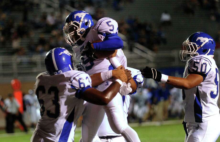 Adonis Hulbert (5) celebrates with his Jay teammates after one his five touchdowns against Taft on Thursday night at Farris Stadium. Photo: Billy Calzada, San Antonio Express-News / © 2012 San Antonio Express-News