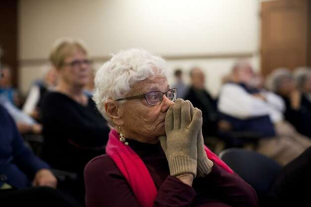 Marilyn Gross and other members of the Rossmoor Democratic Club watch the vice presidential debate at the Creekside Country Club in Walnut Creek. Photo: Jason Henry, Special To The Chronicle