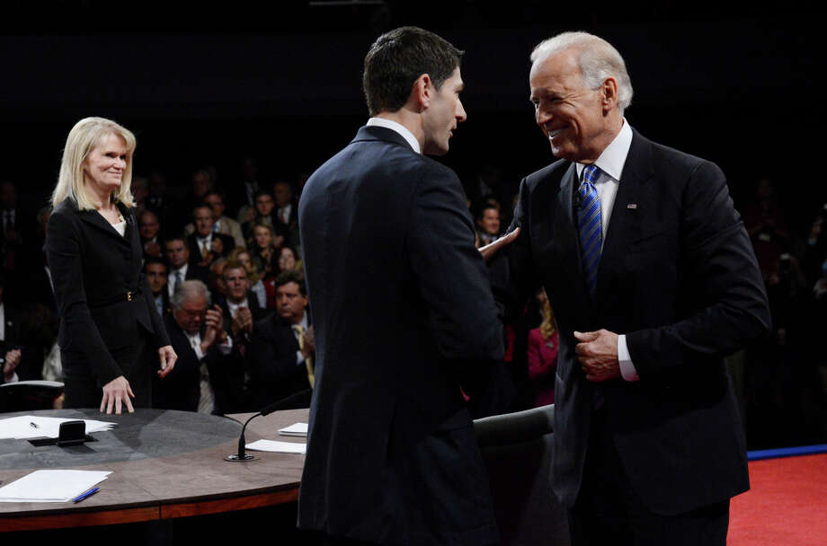 DANVILLE, KY - OCTOBER 11:   Republican vice presidential candidate U.S. Rep. Paul Ryan (R-WI) (C) shakes hands with U.S. Vice President Joe Biden (R) as moderator Martha Raddatz looks on at the end of the vice presidential debate at Centre College on October 11, 2012 in Danville, Kentucky. This is the second of four debates during the presidential election season and the only debate between the vice presidential candidates before the closely-contested election November 6.  (Photo by Michael Reynolds-Pool/Getty Images) Photo: Pool, Getty Images / 2012 Getty Images