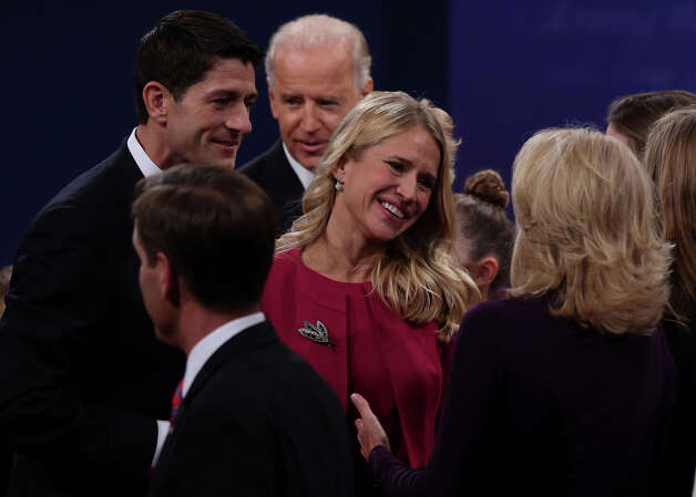 DANVILLE, KY - OCTOBER 11:  Janna Biden (C)speaks with Jill Biden (R)  as U.S. Vice President Joe Biden and  Republican vice presidential candidate U.S. Rep. Paul Ryan (R-WI) look on after the vice presidential debate at Centre College October 11, 2012 in Danville, Kentucky.  This is the second of four debates during the presidential election season and the only debate between the vice presidential candidates before the closely-contested election November 6.  (Photo by Alex Wong/Getty Images) Photo: Alex Wong, Getty Images / 2012 Getty Images