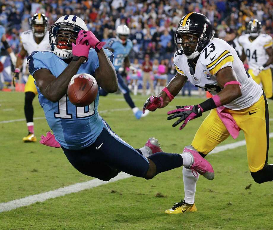 Tennessee Titans wide receiver Kendall Wright (13) can't make a catch as Pittsburgh Steelers cornerback Keenan Lewis (23) defends during the first half of an NFL football game Thursday, Oct. 11, 2012, in Nashville, Tenn. (AP Photo/Joe Howell) Photo: Joe Hoewll