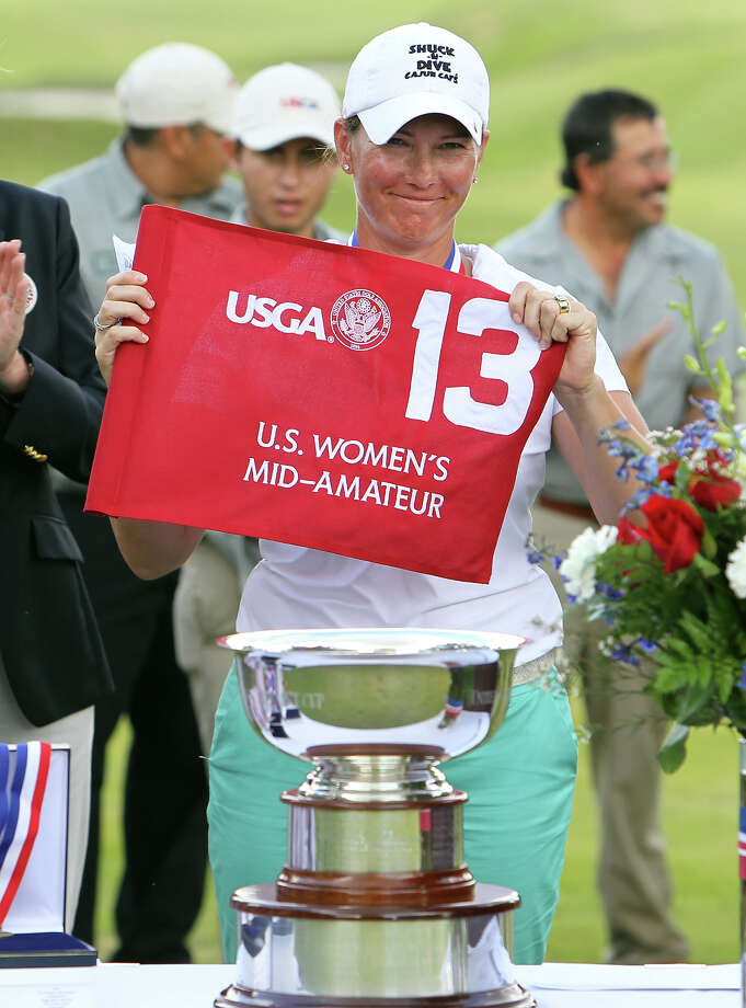 Meghan Stasi of Oakland Park, Florida shows the flag at the hole which she eventually defeated Liz Waynick of Scottsdale, Arizona, 6&5, during the trophy presentation at the USGA U.S. Women's Mid-Amateur Championships at Briggs Ranch Golf Club on Thursday, Oct. 11, 2012. Stasi won the title for the fourth time. Photo: Kin Man Hui, San Antonio Express-News / © 2012 San Antonio Express-News