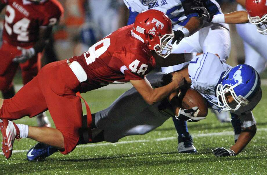 Dae Ross (7) of Jay is tackled by Evan Avitua of Taft after a gain during District 27-5A football action at Farris Stadium on Thursday, Oct. 11, 2012. Photo: Billy Calzada, San Antonio Express-News / © 2012 San Antonio Express-News
