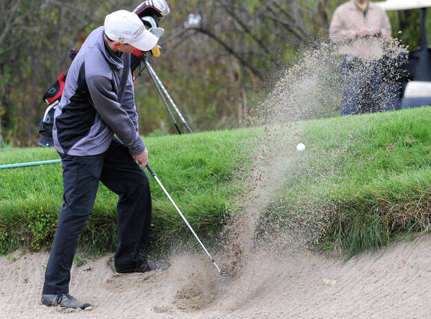 Aaron Simone of Niskayuna hits out of a bunker during the Section II state qualifier golf tournament at Orchard Creek Golf Course Thursday, Oct. 11, 2012 in Altamont, N.Y.  (Lori Van Buren / Times Union) Photo: Lori Van Buren