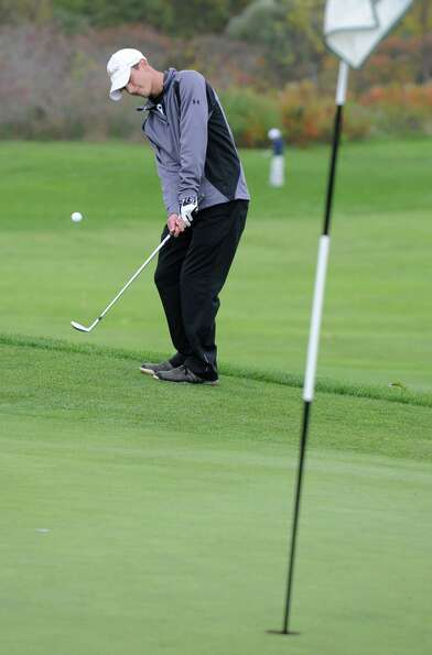 Aaron Simone of Niskayuna chips onto the green during the Section II state qualifier golf tournament