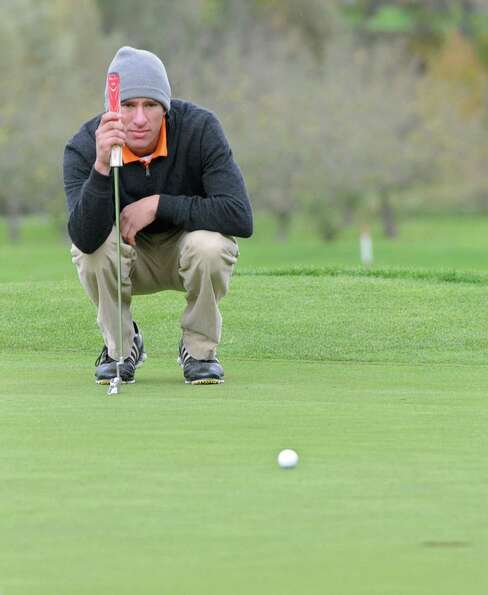 Victor Fox of Bethlehem lines up his next putt during the Section II state qualifier golf tournament