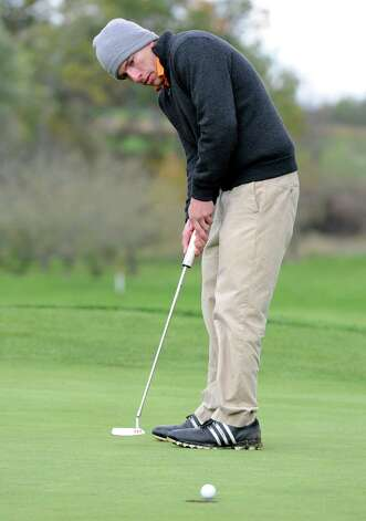 Victor Fox of Bethlehem sinks his putt during the Section II state qualifier golf tournament at Orchard Creek Golf Course Thursday, Oct. 11, 2012 in Altamont, N.Y.  (Lori Van Buren / Times Union) Photo: Lori Van Buren