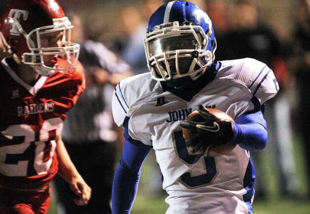 Adonis Hulbert (5) of Jay runs for a first-half score as Tyler Grant of Taft chases during District 27-5A football action at Farris Stadium on Thursday, Oct. 11, 2012. Photo: Billy Calzada, San Antonio Express-News / © 2012 San Antonio Express-News