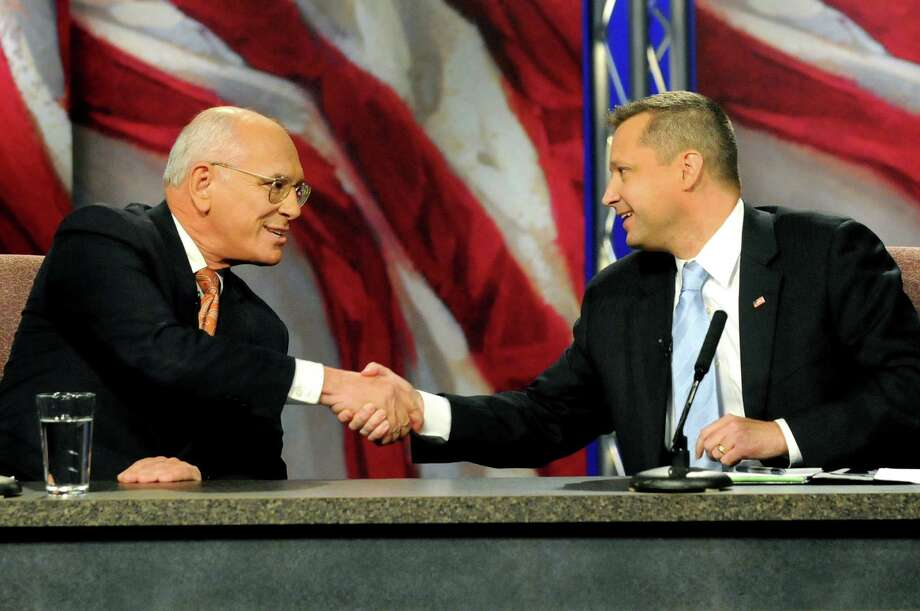 Rep. Paul Tonko, left, and challenger Bob Dieterich shake hands at the conclusion of their debate on Thursday, Oct. 11, 2012, at WMHT Studios in North Greenbush, N.Y. (Cindy Schultz / Times Union) Photo: Cindy Schultz / 00019621A