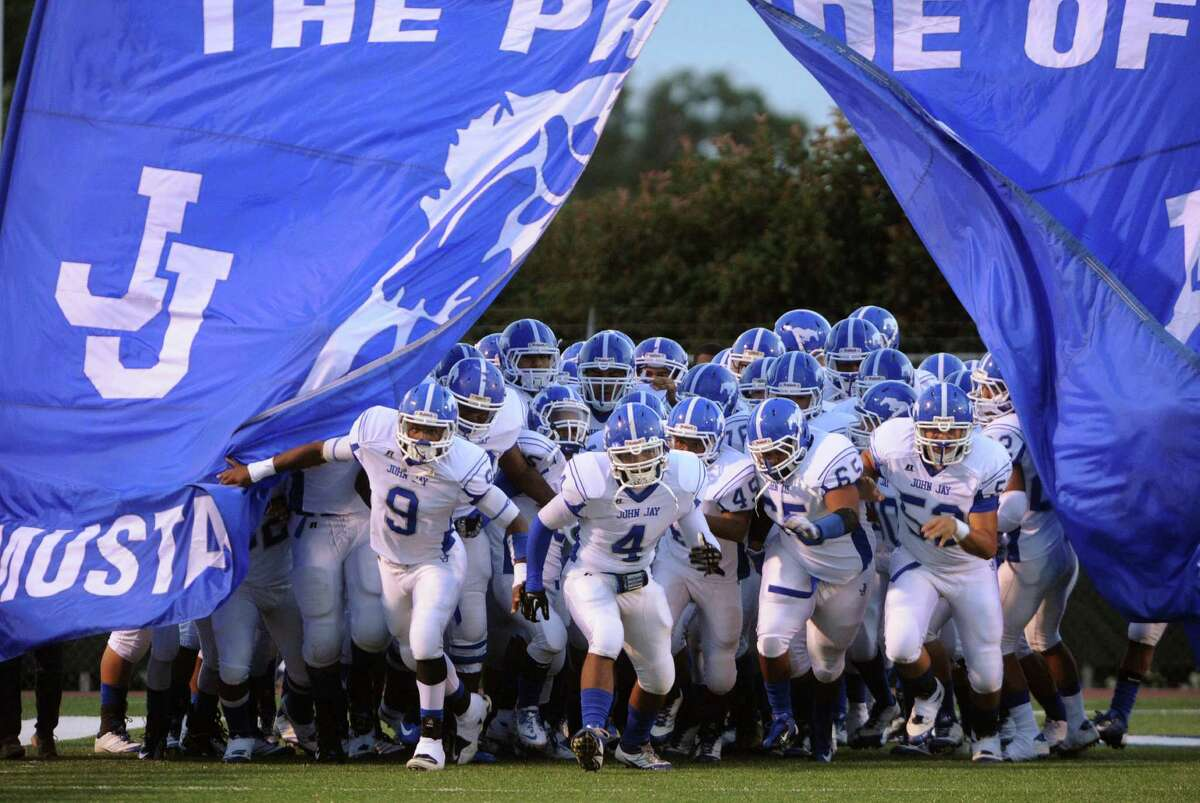 The Jay Mustangs enter the field of play for their game against Taft at Farris Stadium on Thursday, Oct. 11, 2012.
