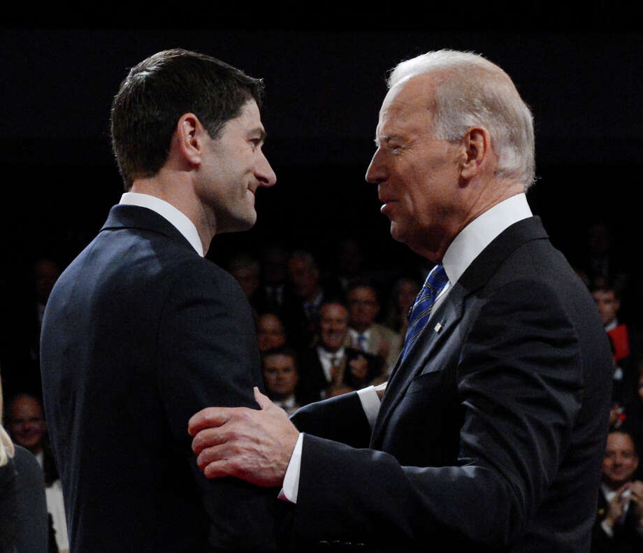 Vice President Joe Biden and Republican vice presidential nominee Paul Ryan of Wisconsin shake hands before the vice presidential debate at Centre College, Thursday, Oct. 11, 2012, in Danville, Ky. (AP Photo/Pool-Michael Reynolds) Photo: Michael Reynolds