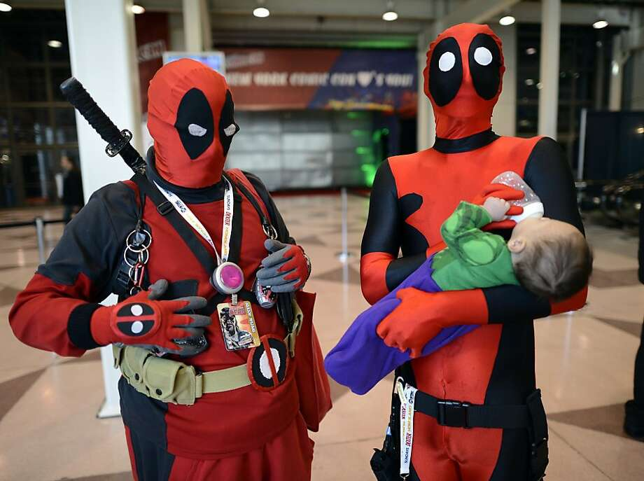 Greetings, Earthlings. Take us to your day care center:Michael Bishop feeds his son, Thomas, while waiting with John Peterson for the opening of the 2012 New York Comic Con at the Jacob Javits Center. Photo: Timothy A. Clary, AFP/Getty Images