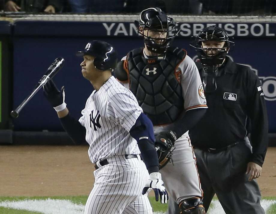 New York Yankees' Alex Rodriguez, left, reacts after striking out with two runners on base in the eighth inning of Game 4 of the American League division baseball series aganst the Baltimore Orioles, Thursday, Oct. 11, 2012, in New York. Orioles catcher Matt Wieters, center, umpire Fieldin Culbreth, right, look on. (AP Photo/Peter Morgan) Photo: Peter Morgan, Associated Press