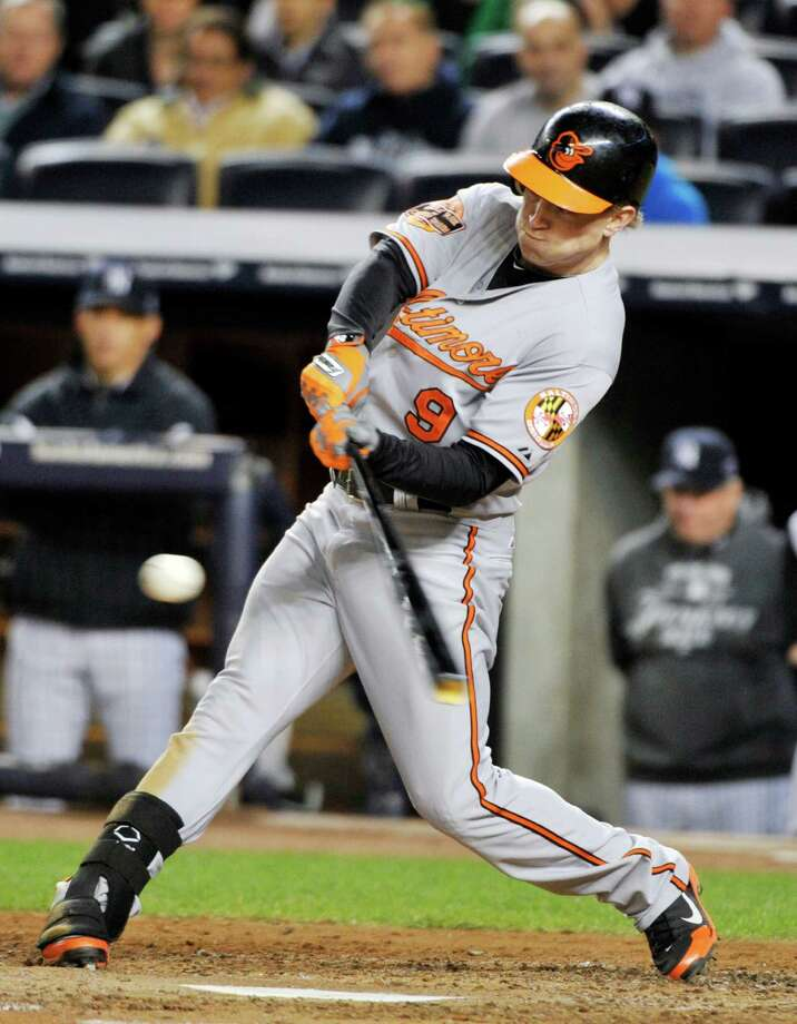 Baltimore Orioles' Nate McLouth hits a home run during the fifth inning of Game 4 of the American League division baseball series against the New York Yankees, Thursday, Oct. 11, 2012, in New York. (AP Photo/Bill Kostroun) Photo: Bill Kostroun