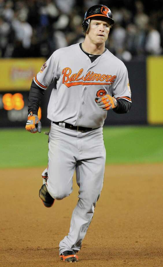 Baltimore Orioles' Nate McLouth runs the bases after hitting a home run during the fifth inning of Game 4 of the American League division baseball series against the New York Yankees, Thursday, Oct. 11, 2012, in New York. (AP Photo/Bill Kostroun) Photo: Bill Kostroun